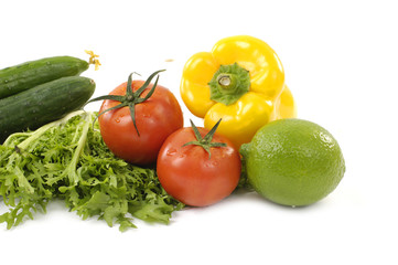 Vegetables and tomato and lemon isolated on white