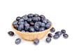 fresh blue plums in fruit basket on the white background
