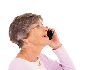 cheerful elderly lady talking on smart phone isolated on white