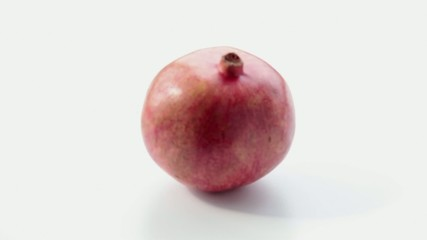 Pomegranate on a white background. Part 1.