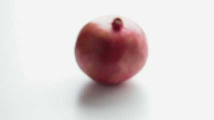 Pomegranate on a white background. Part 2.