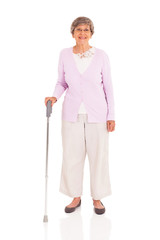 senior woman with walking cane isolated on white background