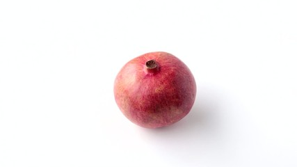 Pomegranate on a white background. Zoom.