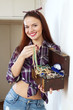 happy woman with jewelry in treasure chest