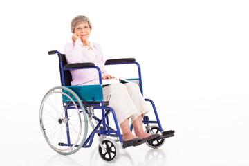 elegant senior woman sitting on wheelchair isolated on white