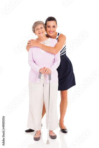 adult granddaughter and senior grandmother isolated on white