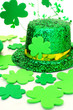 Shiny St Patricks Day hat with shamrocks over white