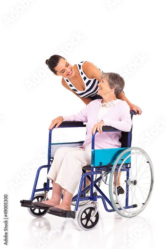 caring daughter talking to disabled senior mother