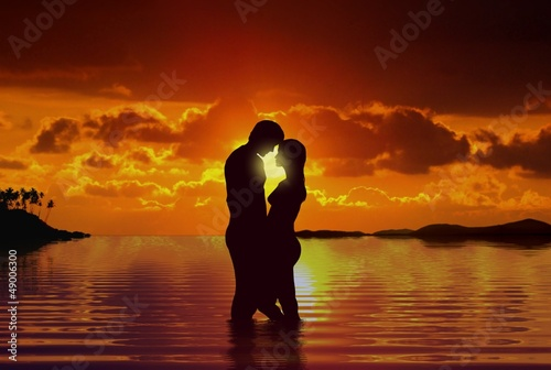 Couple at beach under sunset