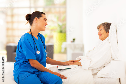 friendly nurse visiting recovering senior patient