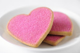 Sugar coated valentine day cookies in a white plate.
