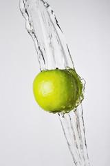 Green apple and water splash