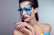 Fashion Makeup. Butterfly face art woman Portrait.
