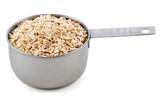 Porridge oats presented in an American metal cup measure