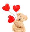 Teddy bear with red hearts