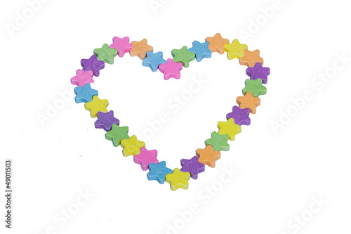 Conversation Hearts in the Shape of a Heart on a white backgroun
