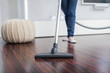 Attractive Female with Vacuum Cleaner - 49012192