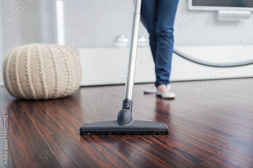 canvas print picture Attractive Female with Vacuum Cleaner