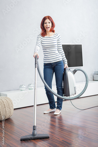 Attractive Female with Vacuum Cleaner