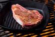 Raw Steak on a Grill