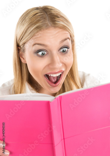 Shocked attractive woman reading book or diary
