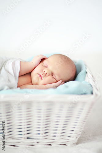 Baby sleeping in a basket