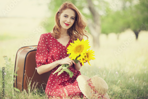 Redhead girl with sunflower at outdoor. - 49014783