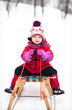 Little girl on sled