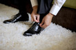 canvas print picture - Groom Tying Shoes