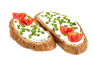 Two sandwich with cream cheese and tomatoes
