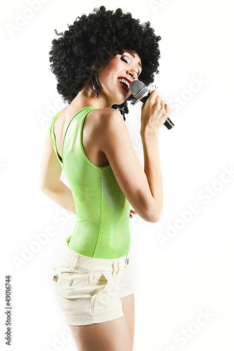 woman with microphone singing disco and dance