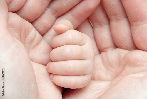 Baby hand in mother's hands