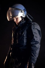 Police Officer Wearing Protective Uniform