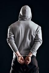 Arrested Criminal in Handcuffs