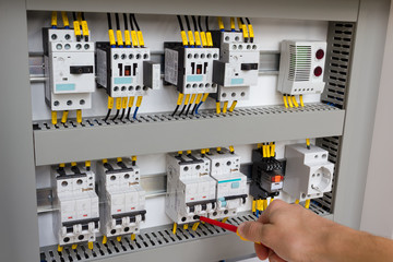 Technician working at electrical cabinet