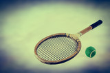 vintage tennis racquet and ball