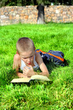 Little Boy Reads Book