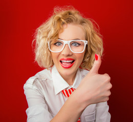 Cheering stylish woman showing thumbs up gesture