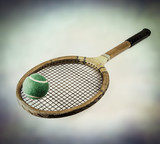 vintage tennis racket and ball