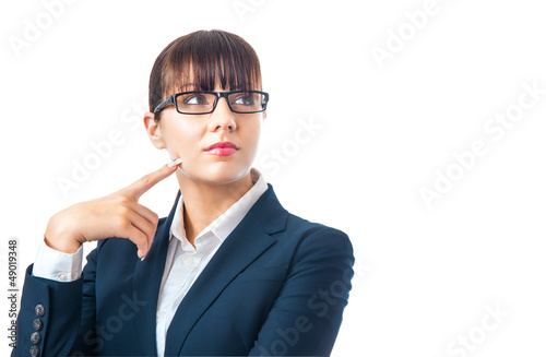 Young businesswoman thinking and looking sideways