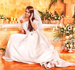 Woman wearing wedding dress.