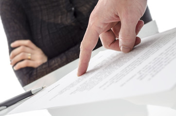 Hand showing a woman to sign a paper