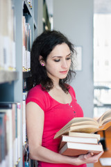 Potrait of a college student in a library