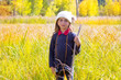 Explorer binocuar kid girl in yellow autumn nature