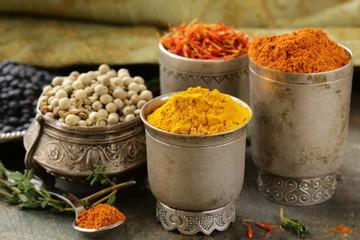 various spices (turmeric, paprika, saffron, coriander)