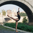 Young beautiful ballerina dancing under Castel Santangelo bridge