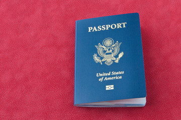 American passport  on red background.