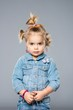 Funny little girl isolated on grey