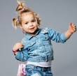 Funny little girl with small bag