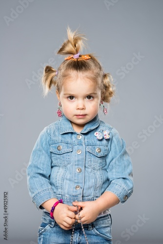 Funny little girl isolated on grey